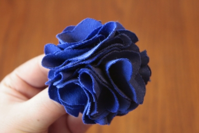 A ruffly blue fabric flower